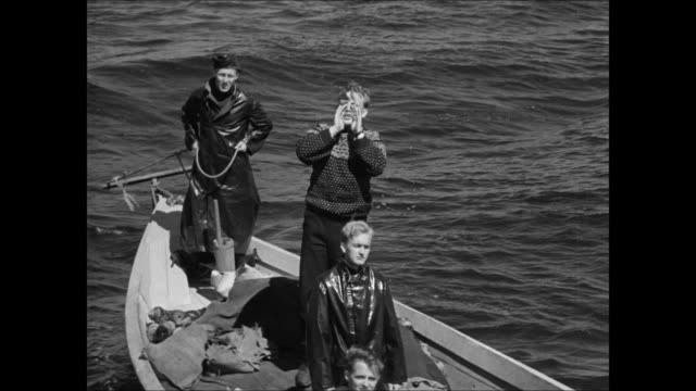 Norwegian natives on boat / MS English guard at post / HA WS Norwegians arriving on boat shouting to guard / British soldiers at post / WS Men...