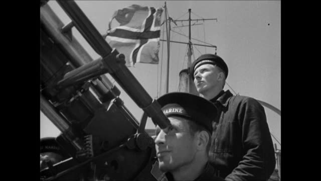 MS Norwegian Navy officer looking w/ binoculars / WS Norwegian gunboat at sea / MS Sailors looking through gun sight Norway flag BG / MS Sailors...