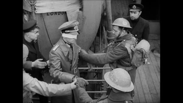 MS Norwegian soldiers holding gun on German Nazi official on street HA MS Blindfolded Nazi officer lead onboard ship MS Blindfolded Nazi soldiers