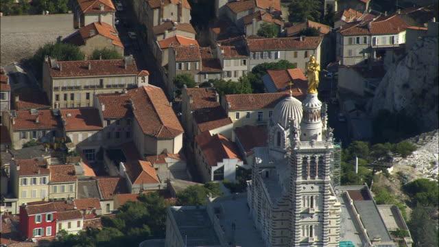 AERIAL Notre Dame de la Garde/ ZO Rooftops and harbor with marina/ Marseilles, France