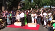 Grenfell ceremony ENGLAND London Notting Hill EXT People gathered for remembrance ceremony in remembrance of Grenfell Tower victim / Doves released...