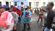 Notting Hill Carnival general views ENGLAND London Notting Hill General views of Noting Hill Carnival / revellers along wearing waterproofs and...