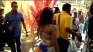 general views Women dancing / woman dancing wearing pink transparent wings / carnivalgoer posing with dancer wearing transparent wings / people along...