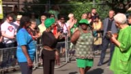 Grenfell Tower ceremony ENGLAND London Notting Hill EXT People gathered for remembrance ceremony in remembrance of Grenfell Tower victims Speeches...