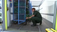 London Ambulance Service preparations ENGLAND London New Scotland Yard EXT London Ambulance Service paramedics setting up medical equipment and...