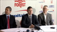 Davies press conference ENGLAND Nottingham Cuty Ground INT New Nottingham Forest Manager Billy Davies into room with Nottingham Forest Chief...