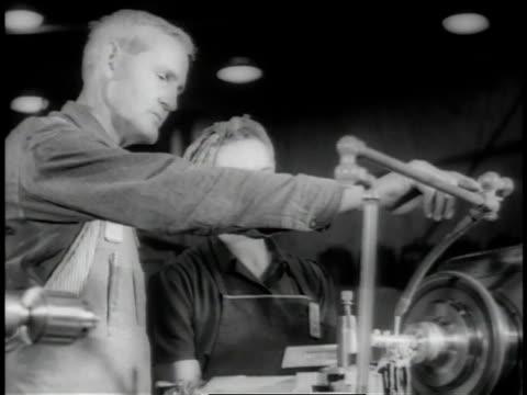 November 1942 LA Machinist instructing woman at metal lathe / Long Beach, California, United States