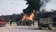 November 1942 WS Soldiers watching a burning fuel tanker truck with billows of black smoke near the harbor / Casablanca Morocco