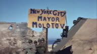 November 1942 MS US Army soldiers sitting atop ruined Vichy French fort and next to tent with sign reading 'New York City Mayor Molotov'