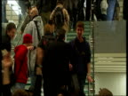November 2007 MONTAGE Shoppers walking down stairs and holding new Apple iPhone aloft for applauding crowd past others in queue/ London UK/ England/...