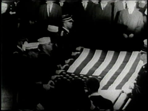 November 25 1963 MONTAGE Mourners surrounding casket of John F Kennedy at Arlington Cemetery / Washington DC United States