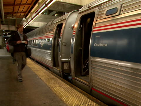 November 25 2009 PAN Commuters boarding Amtrak train at platform / United States