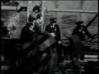 November 26, 1931 MONTAGE men unloading cargo onto customs truck / New York, New York, United States