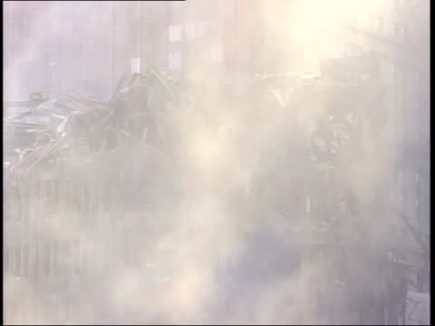 November 6 2001 MONTAGE World Trade Center Ground Zero devastation with cleanup underway and firemen hosing down the dust and debris / New York City...