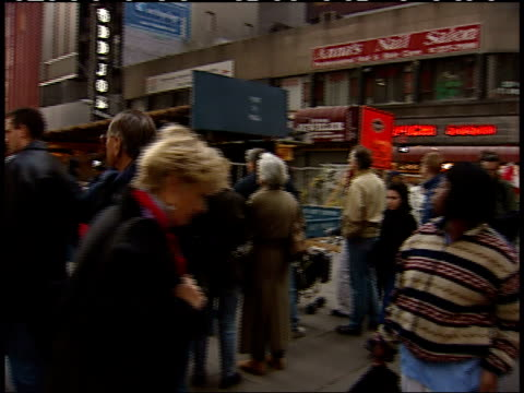November 6 2001 PAN Pedestrians and tourists crossing a city street and stopping to look at the still smoking remains of the World Trade Center as...