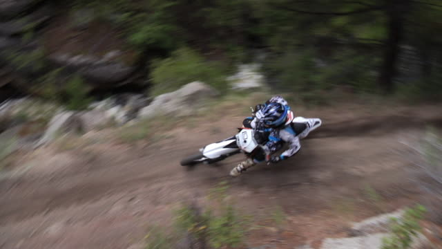 November 9 2009 T/L A professional freestyle motocross rider making an off roads run through the woods