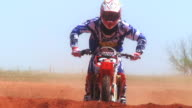 November 9 2009 MONTAGE Professional supercross rider performing basic track jumps