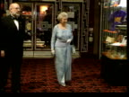 November In 2002 the Queen came forward to save Paul Burrell LIB Queen along at Bombay Dreams film premiere LIB Burrell surrounded by police officers...