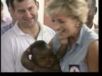 November LIB Luanda INT Princess Diana holding baby with Burrell in background