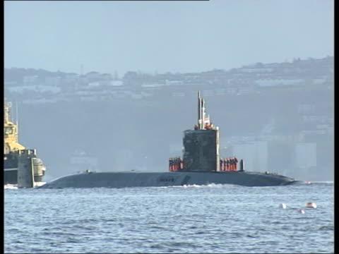 Faslane Partially submerged nuclear submarine HMS Trafalgar along thru water on return to dock Crew on top of vessel as thru water with coastguard...