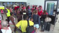 A number of hurricane victims from the island of Saint Martin were evacuated by plane to Guadeloupe on Saturday most of them women and children
