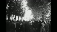 VS numerous French people legislators and watchful gendarmes gathered under trees near the Vichy opera house / Note exact day not known
