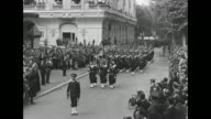 Numerous high angle and street views of military parade and Prime Minister Philippe Petain reviewing the troops / Note exact day not known