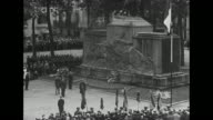 Numerous view of dignitaries laying wreaths at moment to Vichy's WWI war dead / woman with handkerchief weeping / Prime Minister of France Philippe...