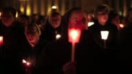 Nuns and pilgrims having a candle lit vigil to give thanks to Pope Benedict XV1 on the eve of his retirement General views Around Vatican City on...