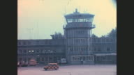 Nuremberg Airport in Bavaria plane taxis waiting in front of the airport traffic control tower people and police men in front of the main entrance...