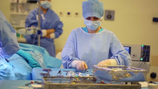 Nurse assisting doctor