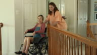 Nurse Assisting Wheelchair Bound Female in Home