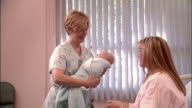 SLO MO, MS, Nurse bringing newborn baby to mother in hospital room