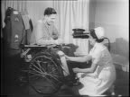 A nurse checks the leg prosthesis of soldier Vincent Booth in uniform soldier speaks of simple things people at home can do to help the war effort