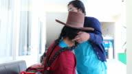 A nurse examines a Peruvian woman at a medical clinic in Cusco, Peru.