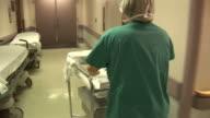 HD: Nurse Quickly Walks through Hospital