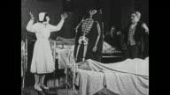 Nurse (Hazel Newman) runs screaming from man dressed in skeleton poster