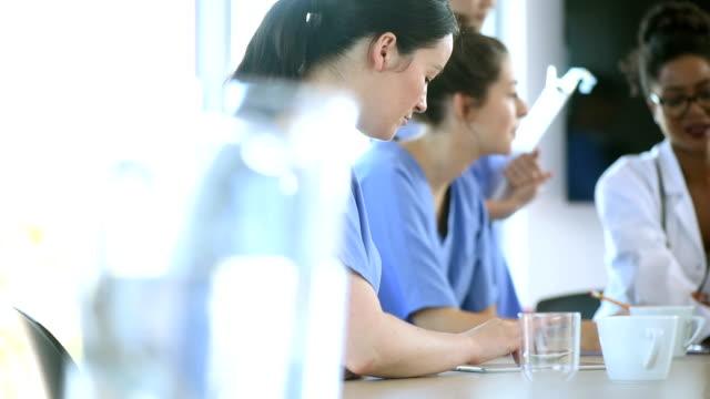nurse team meeting in a hospital