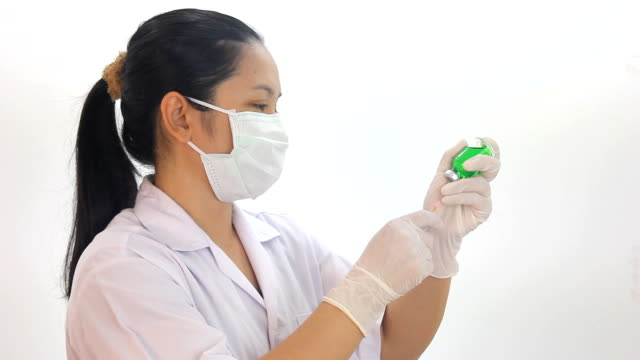 Nurse using Syringe