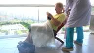 Nurse with happy senior woman in nursing home.