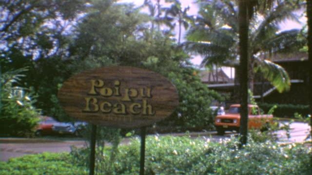 Oahu Freeway / Poipu Beach Signage / View of Condo / Shots of people in the water on the Beach / Poipu Beach on August 05 1975 in Kauai Hawaii