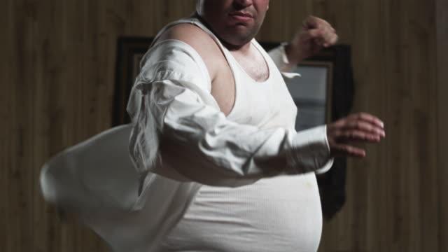 MS TU SLO MO Obese man dancing in living room / Orem, Utah, USA