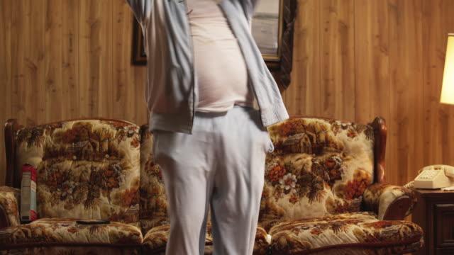 MS TU Obese man exercising in living room / Orem, Utah, USA