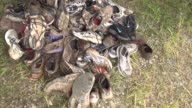 Obstacle Race Spartan entrants pushed to limits shoes in pile donated after race