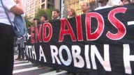 Occupy Wall Street Protestors Call for a Robin Hood Tax on the Wealthy on Its Two Year Anniversary Protestors Hold Up Banner at Demonstration at...