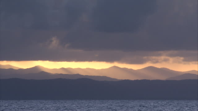 WS Ocean and mountains under setting sun / Great Barrier Reef, Australia