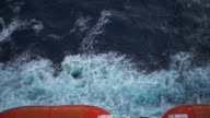 Ocean big waves to the passage of a ship