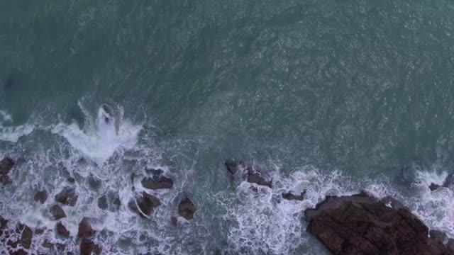 Ocean Waves Crashing into Lava Rock