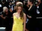 Ocean's Thirteen Arrivals for film premiere Actress Angelina Jolie posing for press on red carpet/ Brad Pitt and partner Angelina Jolie posing...