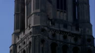 Octagonal towers surround the main West tower of Ely Cathedral. Available in HD.